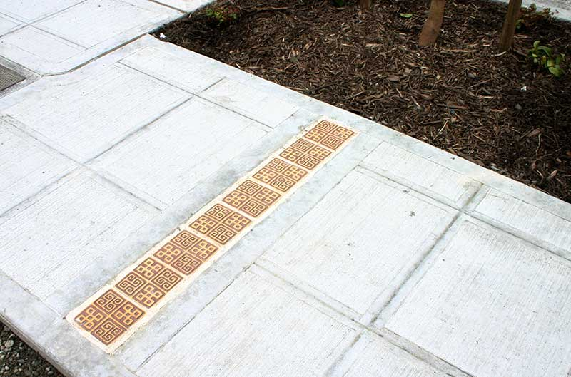 """Convergence"" - public art by Gregory Fields - sidewalk tile strip"