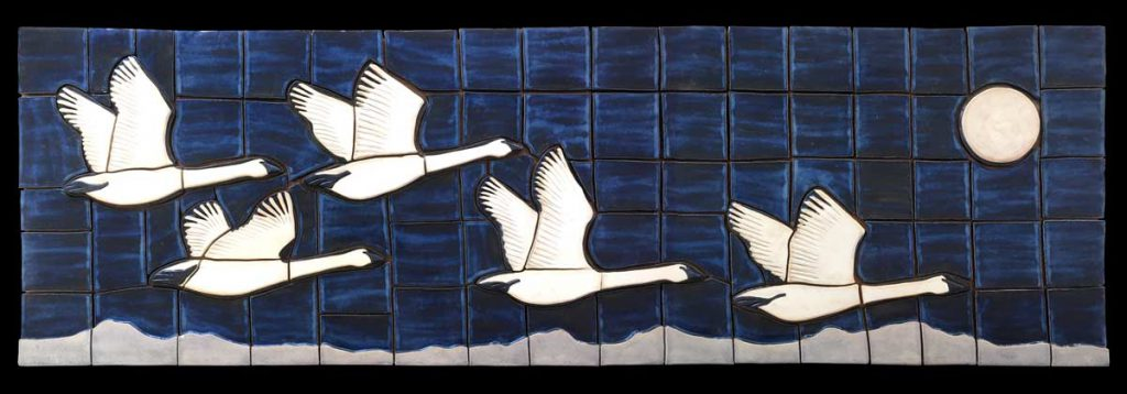 """Trumpeter Swans"" - ceramic mural by Gregory Fields"