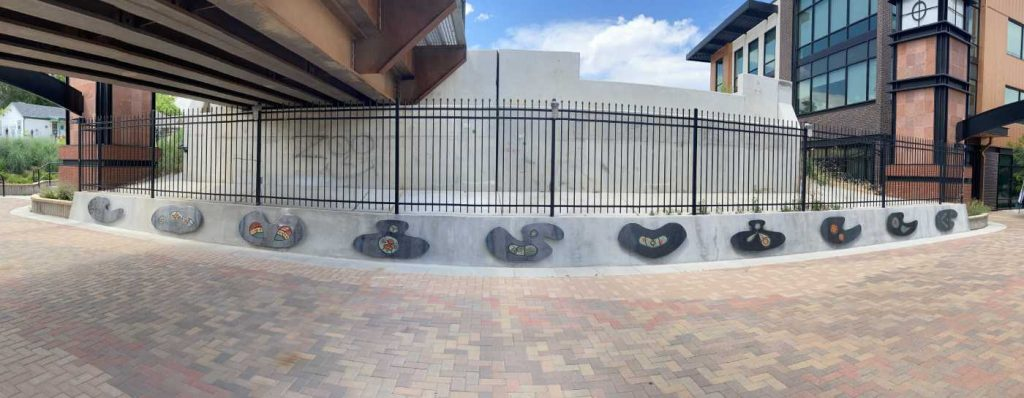 Panorama view showing the art panels of the north side of the underpass