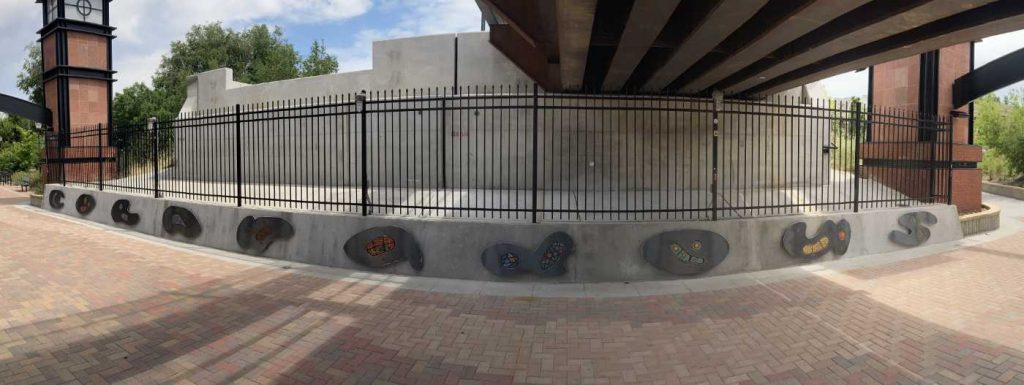 Panorama view showing the art panels of the south side of the underpass