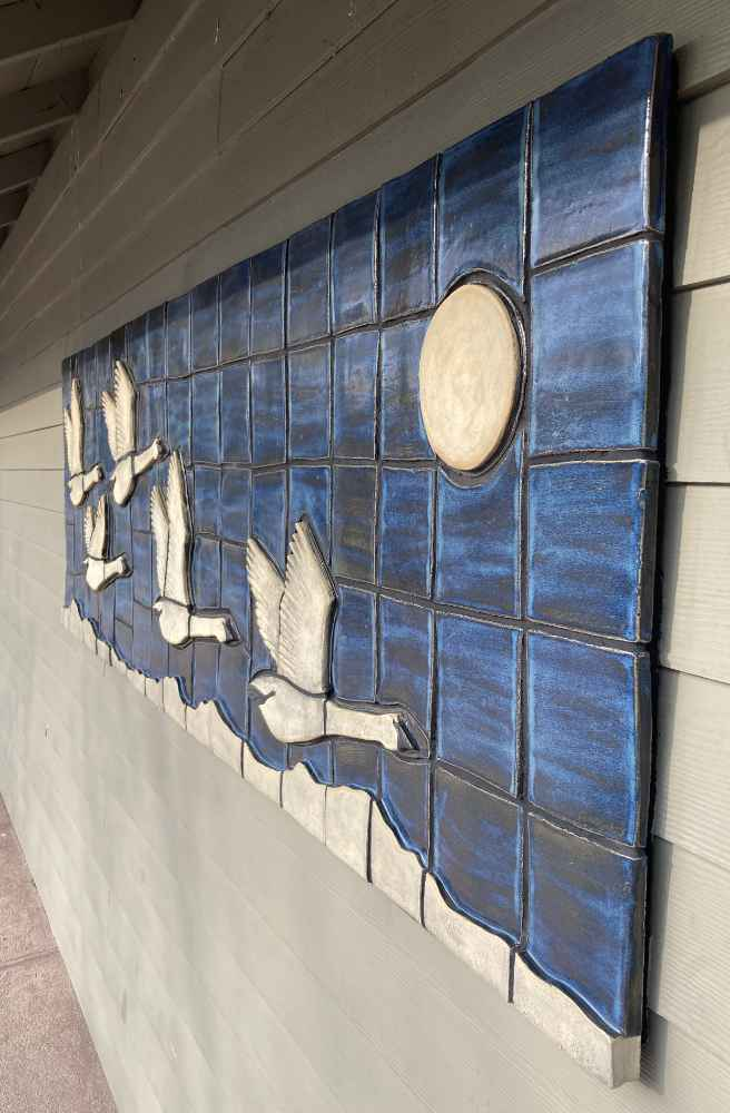 """View from the right side of the """"Trumpeter Swans"""" ceramic mural by Gregory Fields"""